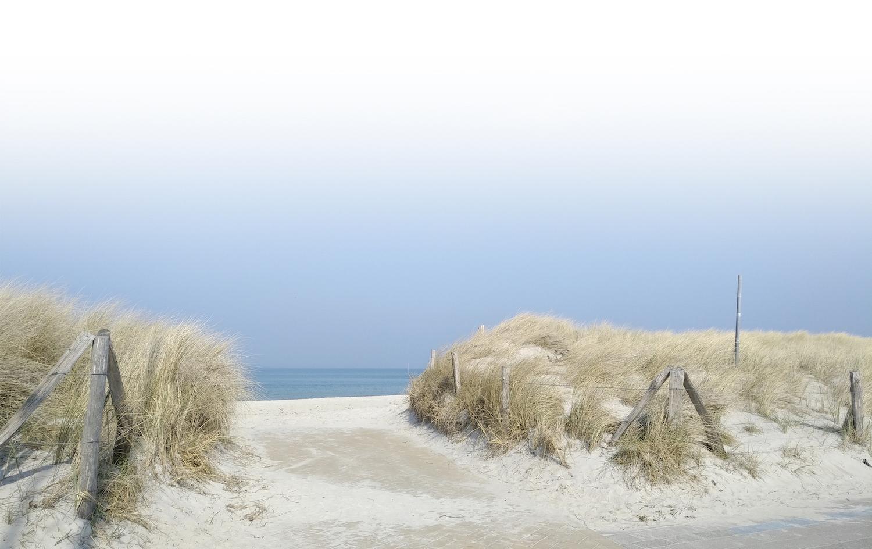 Hintergrund Mobilheim an den Dünen am Strand